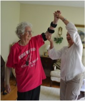 Mavis Beam performs exercises to stretch and increase the range of motion with her surgically-repaired left elbow with Porchlight's Terri Zucker, OT. Anthony DeFelice, DO, performed the successful procedure.