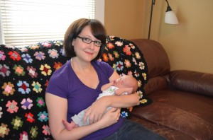 Jennifer Krause and baby Jack sitting at home - happy and healthy with the support of Porchlight VNA